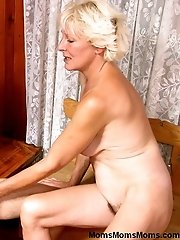 Mature lady in sexy short dress seduces her younger neighbor