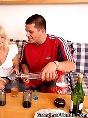The two young guys enjoy fucking the drunken granny in her pussy and her mouth