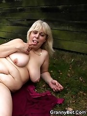 She and her young lover are outdoors and the sexy mature is fucked in her dripping wet pussy