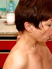 Hot back of lad's mature girlfriend washing dishes in the kitchen makes his dick ready to explode
