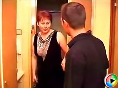 Redhead MILF's desire was too strong and she asked her young visitor fuck her right by the front door