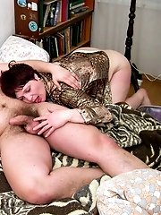 Brunette mom masturbating on the sofa