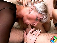 Hot blonde MILF in stockings teaches newly married couple sex and gets some cock too