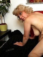 Granny on her hands and knees shakes her ass and he fucks her from behind with long strokes